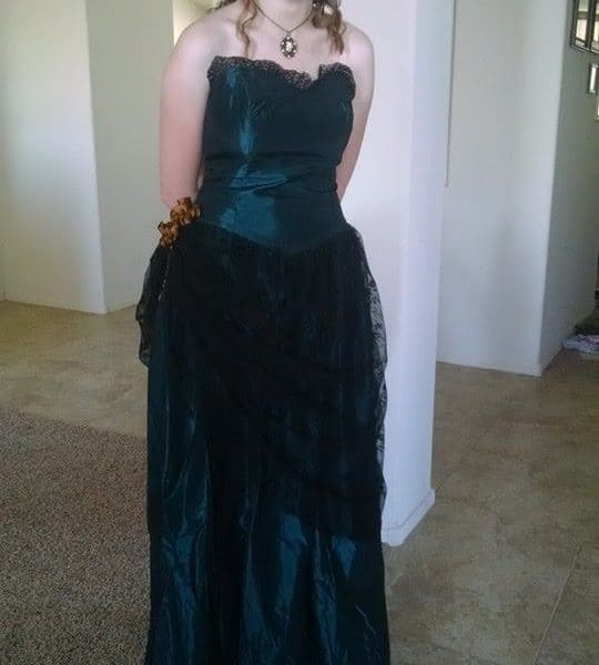 daughter joyful in dress she made - sewing is passion